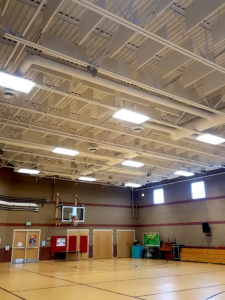 sound baffles in a gym ceiling control noise levels in a loud gym