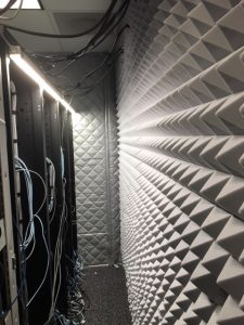 acoustic foam against a back wall behind a computer rack to control computer noise