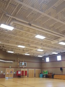 premium sound quality in a gym with acoustic baffles in metal deck