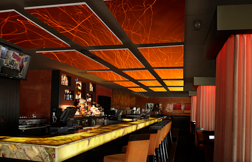 designer sound panels float over bar to control noise exposure levels for bar soundproofing