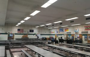 cafeteria noise is controlled with perimeter wall mounted sound panels