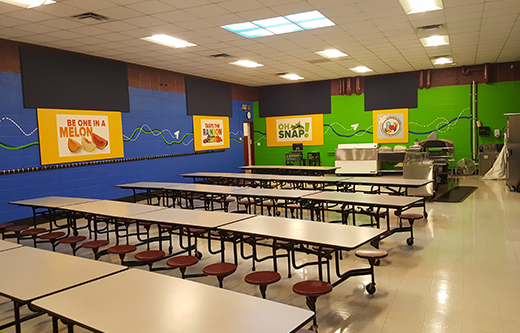 acoustic sound panels in walls to control noise and soundproof a loud cafeteria