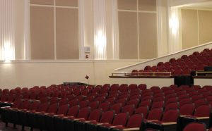 wall mounted sound panels control acoustics for soundproofing an auditorium
