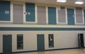 colorful sound panels on a gym wall for soundproofing a gym