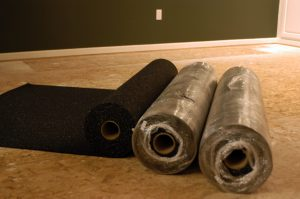 rolls of sound barrier underlayment deadens foot noise