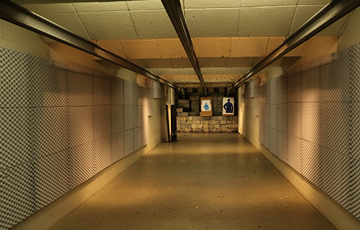 indoor gun range tunnel is soundproofed with acoustic foam panels