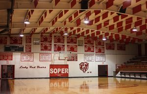 sound baffles in a gym ceiling control echoes to improve room acoustics