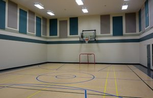 perimeter wall cloth wrapped sound panels control noise levels in a loud gym space