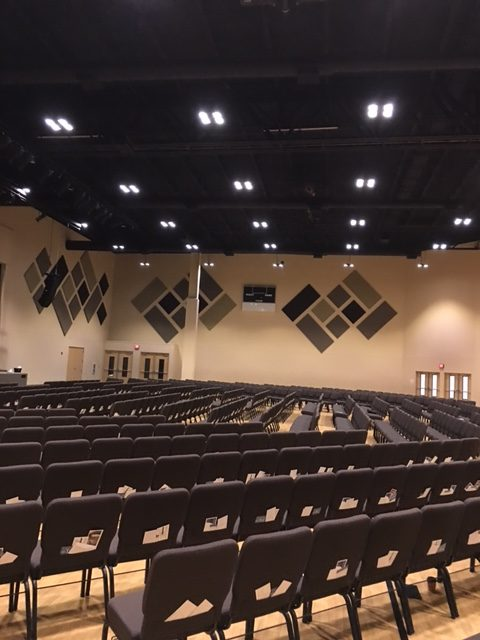acoustics in a sanctuary enhanced with sound panels mounted on perimeter walls