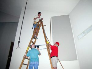 installing sound panels on a wall