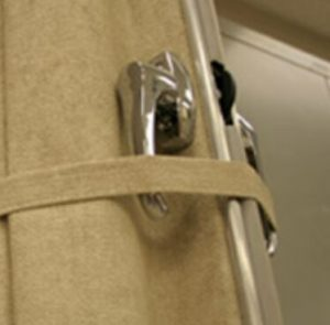 tether straps to help sliding accordion sound barrier curtain system