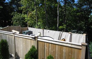 outdoor pool pump noise controlled with exterior sound barrier blankets