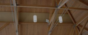 cloth wrapped sound panels flush mounted to a ceiling to control noise levels
