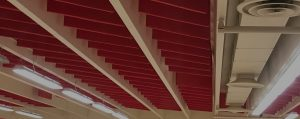 sound control in a gym space with acoustic ceiling baffles
