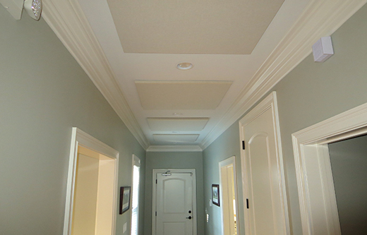office noise control with ceiling mounted acoustic panels in a hallway