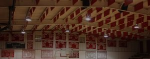 controlling gym noise with sound baffles in the ceiling of a loud gym