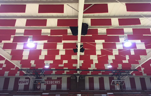 soundproofing a loud gym with red acoustic baffles