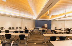 conference room in need of soundproofing with a set of acoustic panels by NetWell