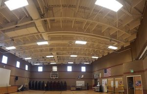 noise control in a gym with sound baffles in a ceiling