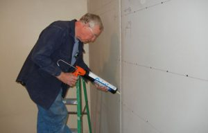 acoustic caulking seams for soundproofing a wall