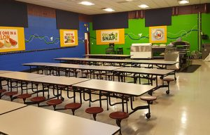 cafetria walls treated with sound panels to lower noise levels in a loud cafeteria