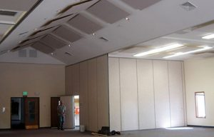 acoustic ceiling clouds control ambient noise levels in a loud cafeteria