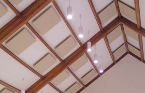 Acoustic Ceiling Clouds Over a Multipurpose Room to Improve Room Acoustics