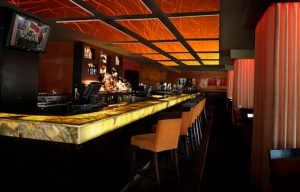 sound panels float over a bar to soundproof the room