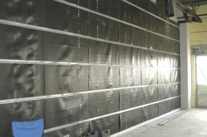 mass loaded vinyl and channel system combats common wall noise bleed