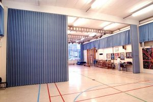 sound barrier accordion style curtain system isolates room noise