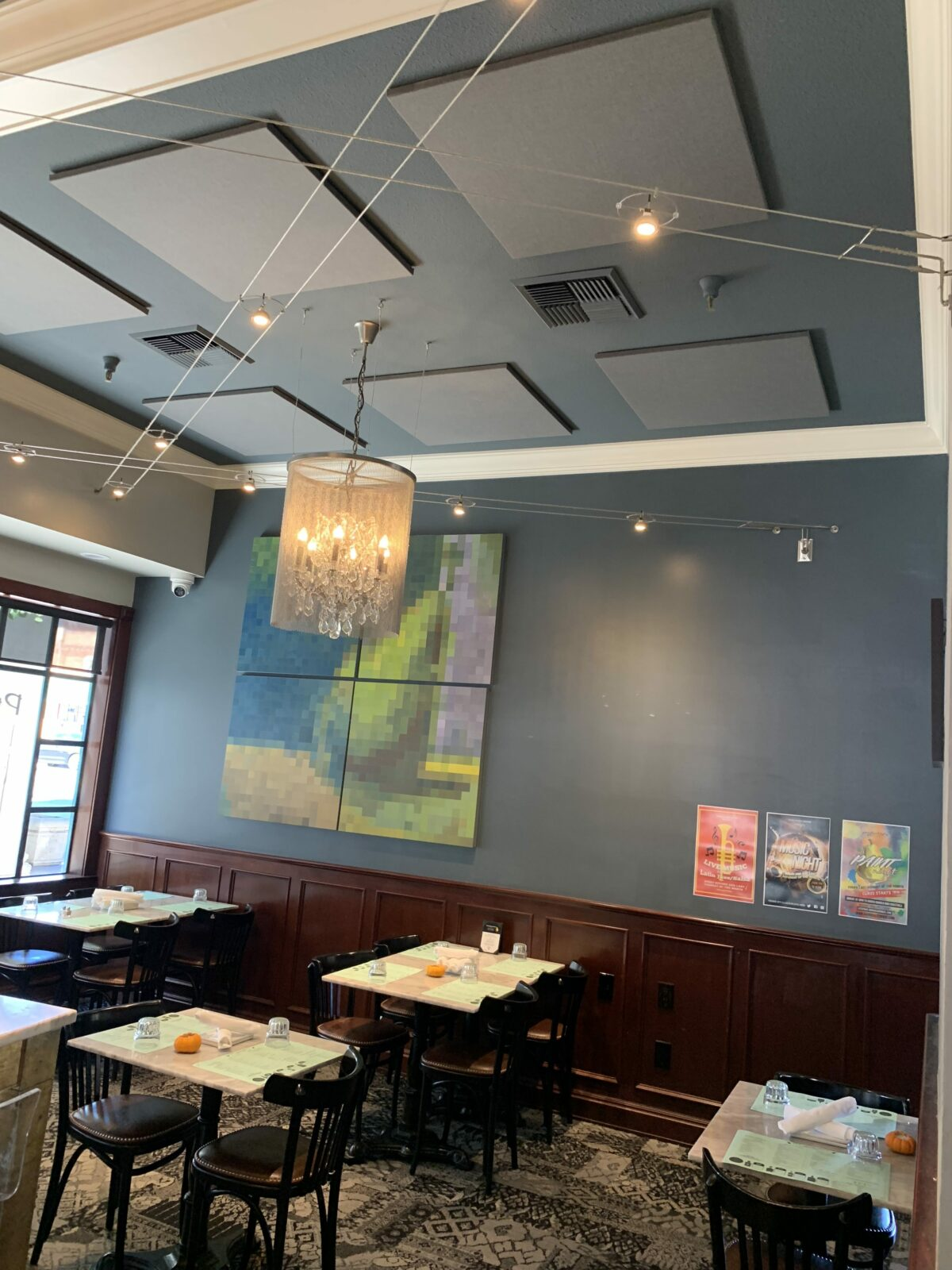 ceiling sound panels control acoustics in a restaurant
