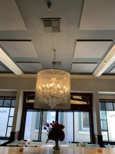 Ceiling soundproofing panels control acoustics in a restaurant