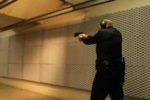Pistol shooting at gun range