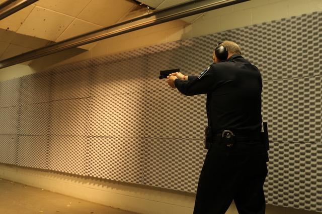 Pistol shooting at gun range